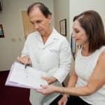Plastic surgeon Dr. Leo McCafferty reviews a treatment plan with patient Sharon Nelson. (Photo by John Altdorfer)