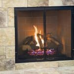 gas fireplace with stone tile surround