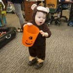 child trick or treats in halloween costume (Photo by Mike Fender)