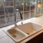Kitchen sink with new faucet in front of window