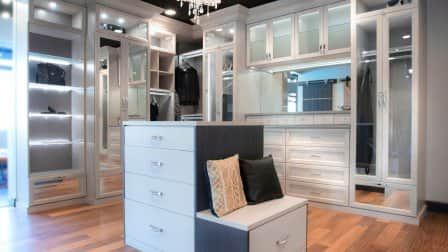 Large walk-in closet by California Closets