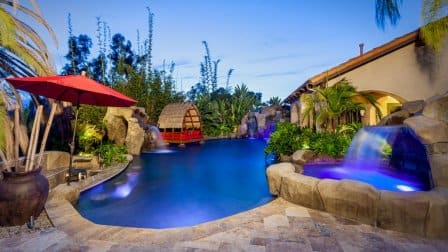 Pool with waterfalls by Distinguished Pools