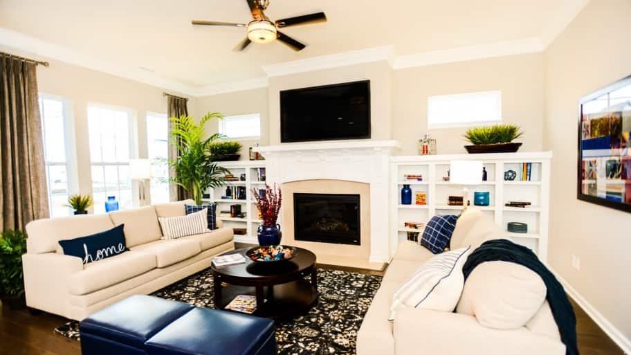 built-in bookshelves in living room with fireplace