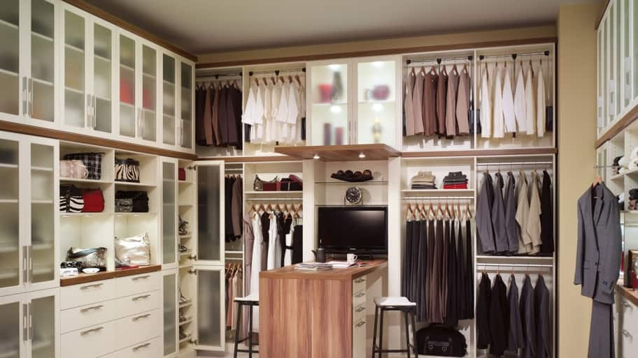 Custom closet system with shelving and a desk
