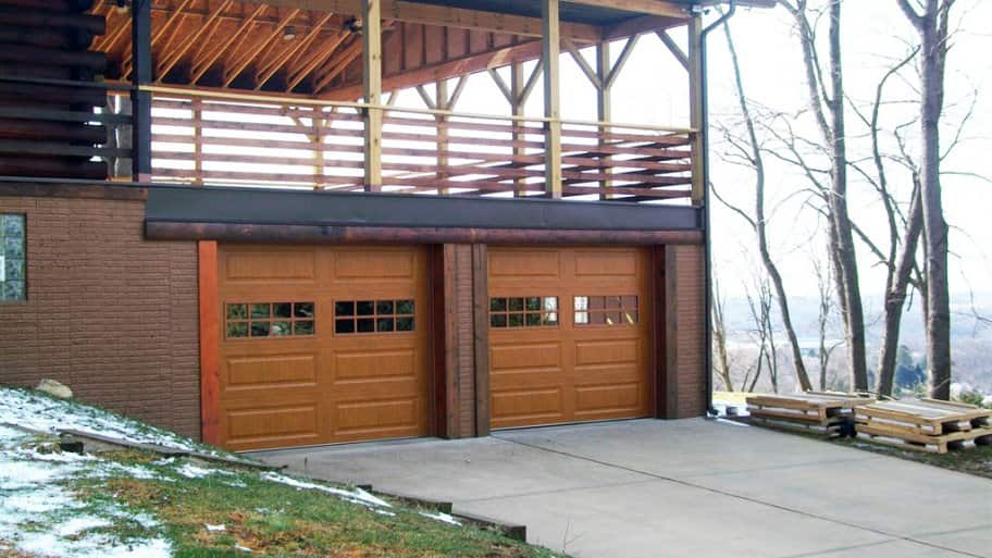 garage and driveway with mountain view