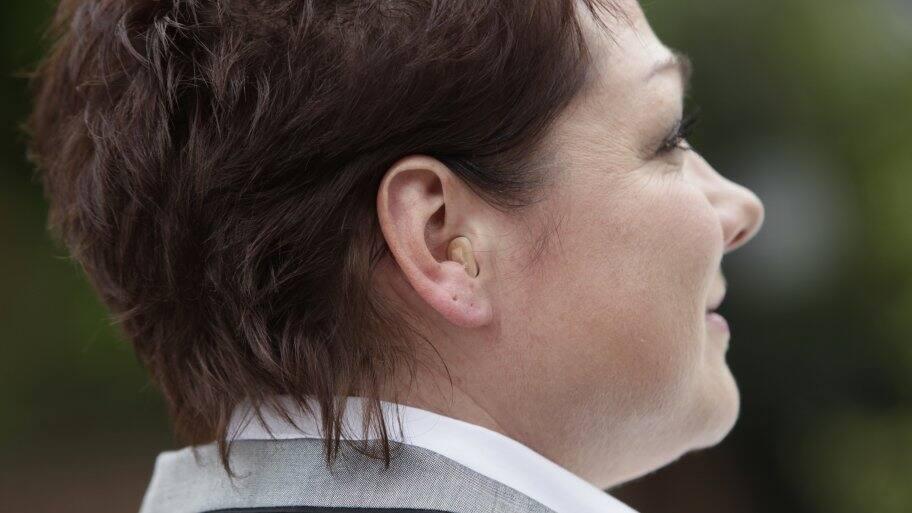 hearing aid in woman's ear