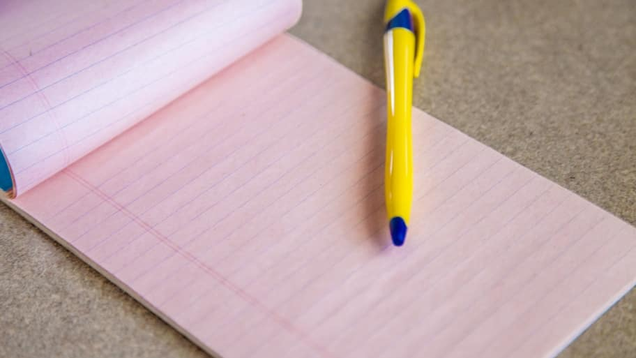 Pen and Notepad for Financial Planning