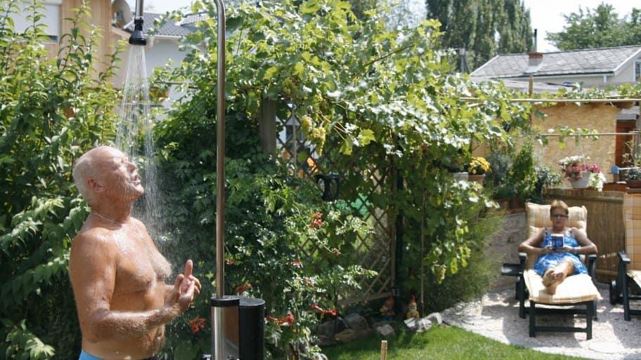 man in outdoor shower