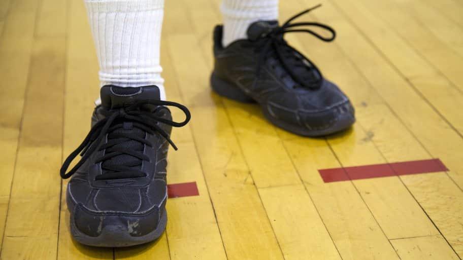 man standing on gymnasium floor