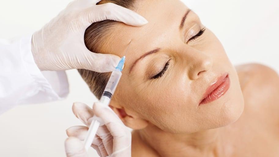 woman getting botox injection