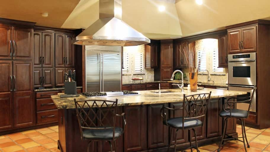 Tukasa Creations kitchen remodel with island and oak cabinets