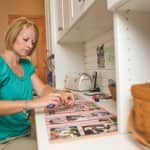 Iva Caldwell scrapbooks in her Zionsville, Indiana, craft room. (Photo by Brandon Smith)