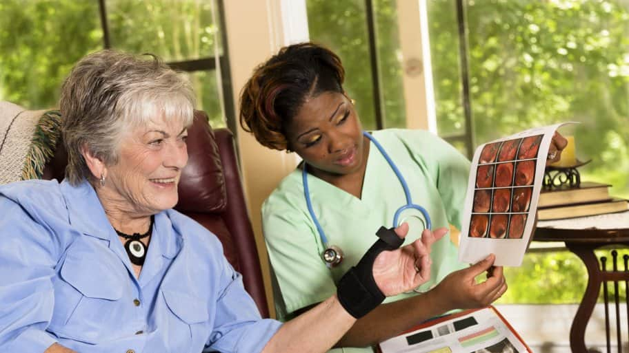 in-home health care nurse with patient