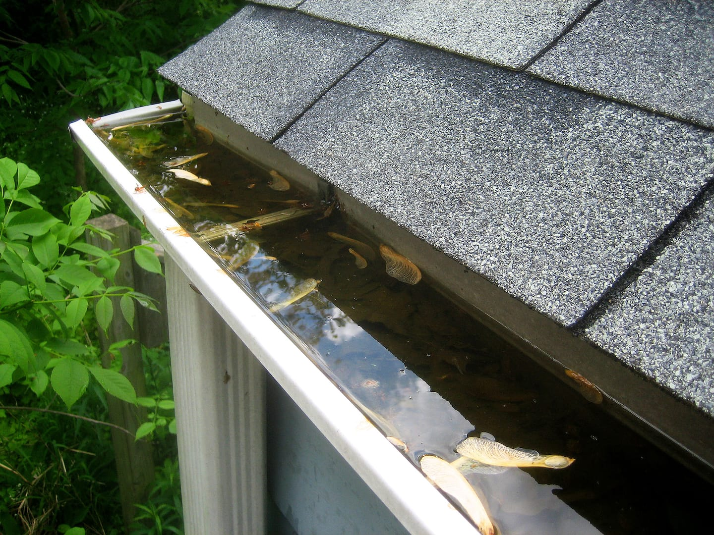 How much to charge for gutter installation - Clogged Rain Gutter Photo By Photo Courtesy Of Eric Schmuttenmaer