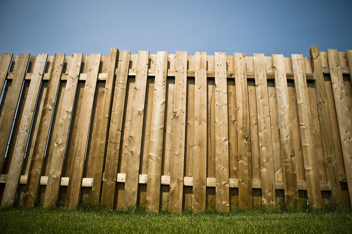 Fences guide to fencing costs materials angies list tall wooden fence baanklon Images