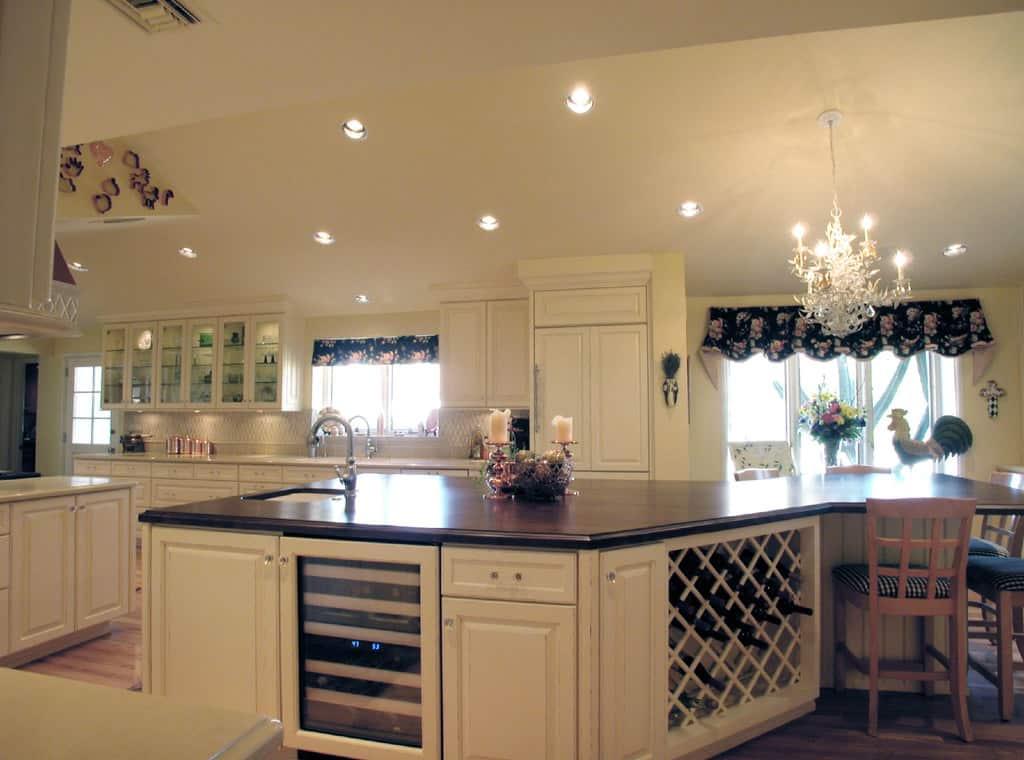 Large white kitchen island with wine rack