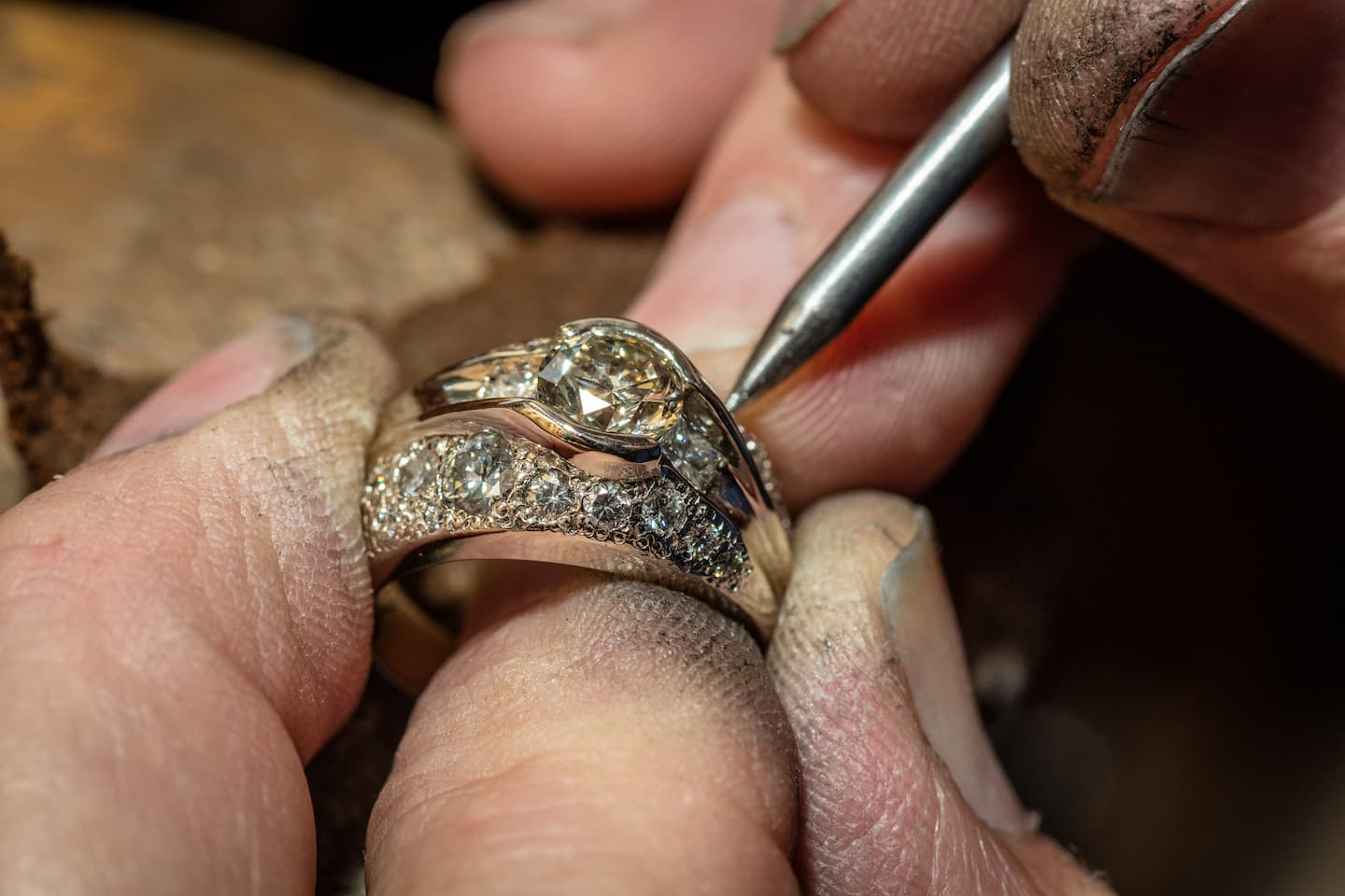 dirty work fingers thumb appraising ring jewelry with tool black dirt and diamond in gold - How Do Wedding Rings Work