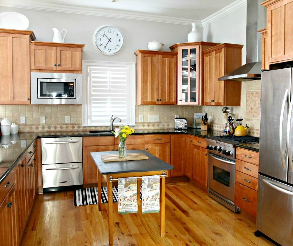 Kitchen With Wood Cabinets Wood Floor Dark Countertop And