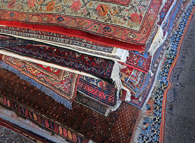 Pile Of Oriental Rugs