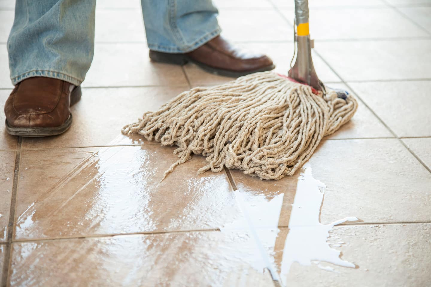 Floor cleaning angies list person mopping tile floor how to keep a tile floor clean dailygadgetfo Choice Image