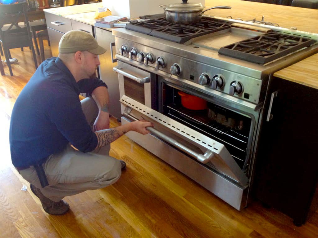 Uncategorized Kitchen Appliance Repairs appliance repair maintenance guide angies list repairman looking into an oven