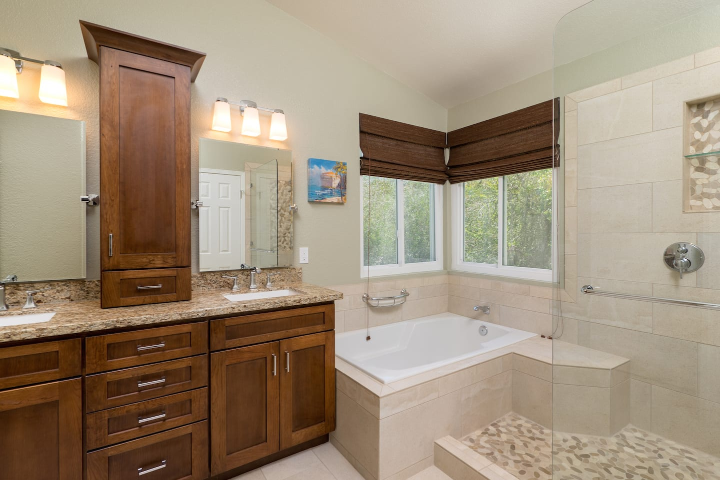 Merveilleux Remodeled Bathroom With Cabinets, Tile And Tub