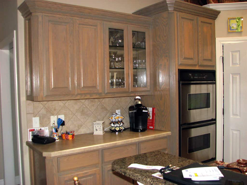 should i paint or refinish my kitchen cabinets  angie's list - staining kitchen cabinets