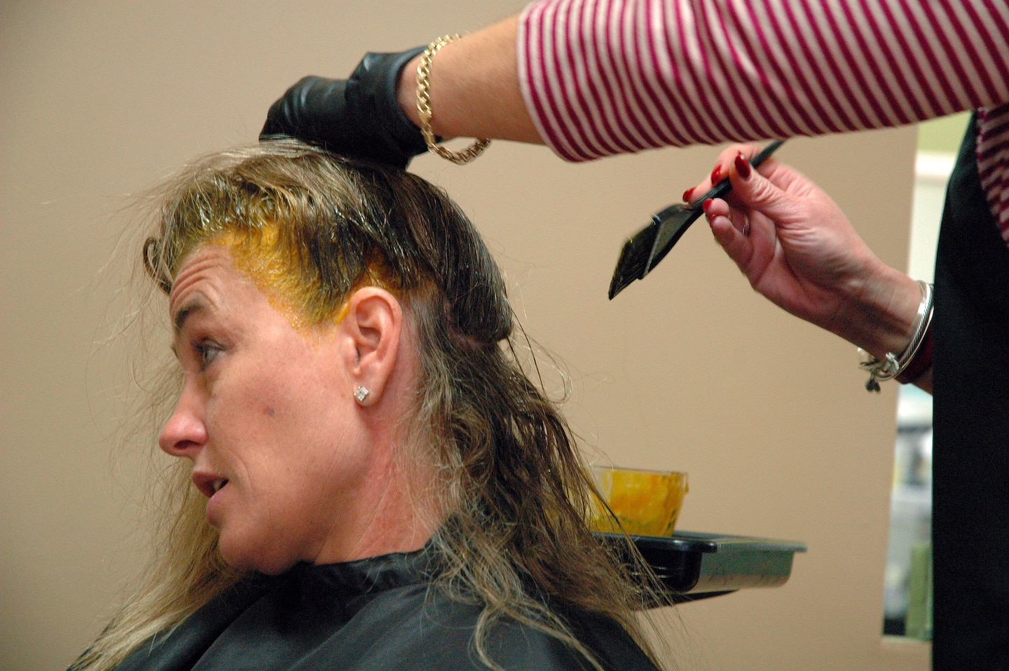 Hairstylist Applying Dye To A Client039s