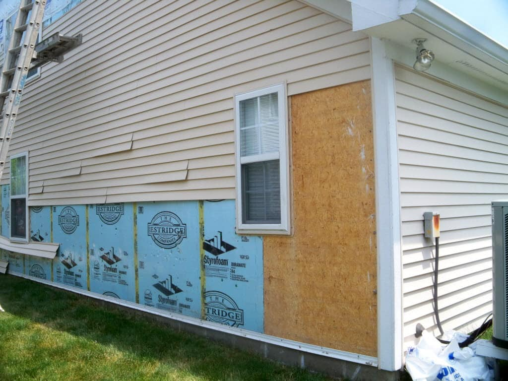 Cost of stucco siding - A House With Some Siding Gone Because Of A Storm