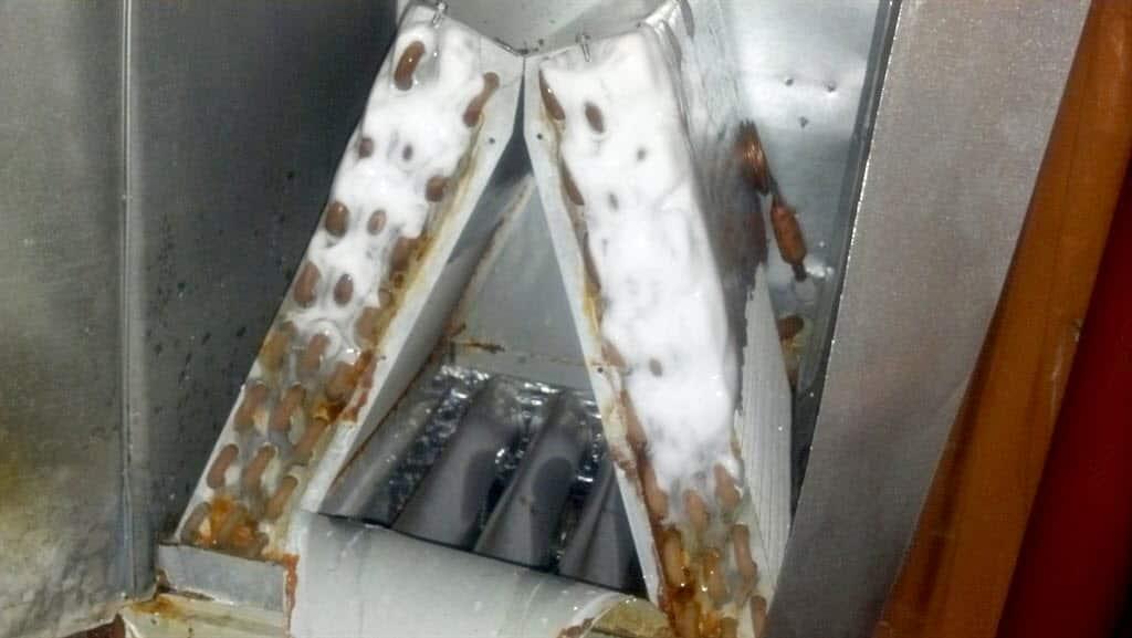 frozen A/C coils inside an air conditioner