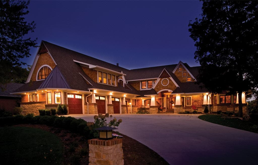 Solutions to 3 top outdoor lighting problems angies list a house lit up at dusk aloadofball Image collections