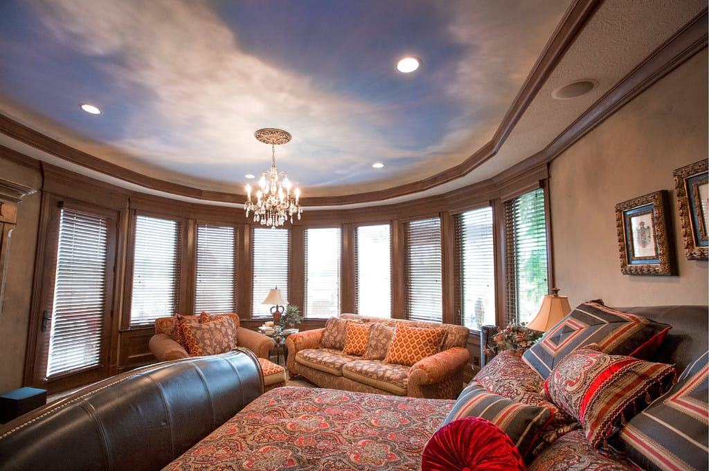 Room with ceiling sky mural by Silver Crow Studios
