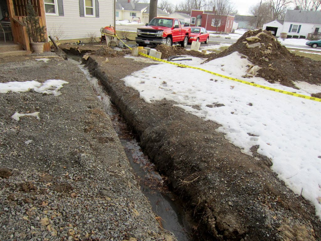 Yard with sewer dug up