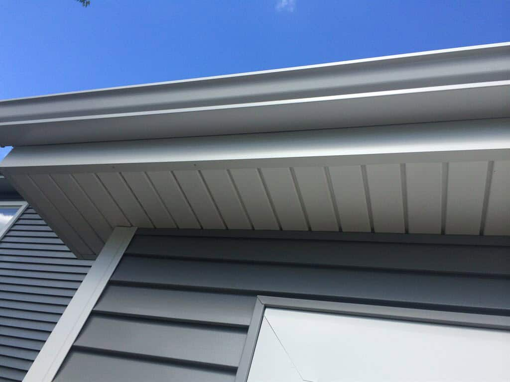 How much to charge for gutter installation - Siding A Gutter And A Window On A House