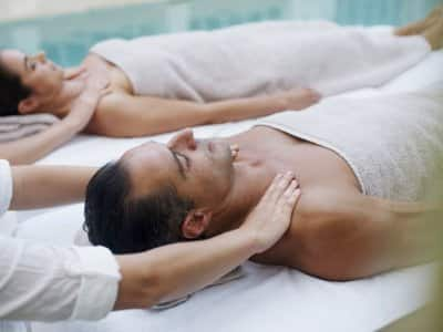 couple getting poolside massages
