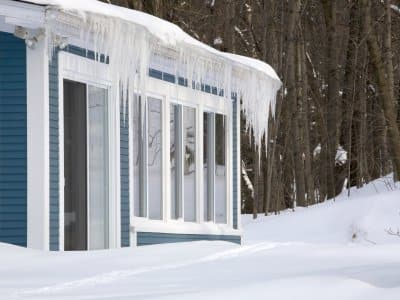 House with icicles and snow