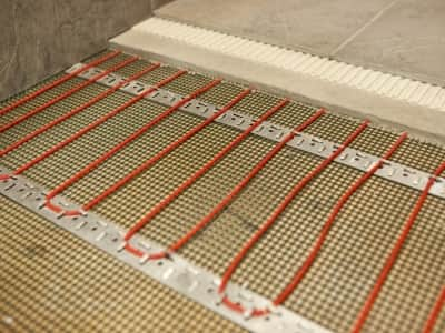 radiant heat floor grid dryfitted before installed beneath floor tile