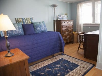 a newly painted bedrom with blue walls