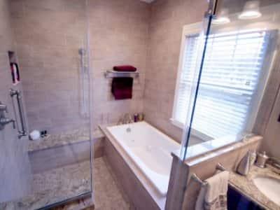 wet room bathroom with tub