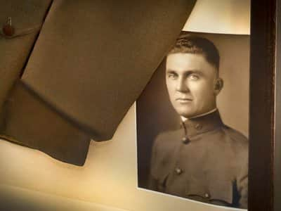 A World War I uniform and photo preserved in a shadow box