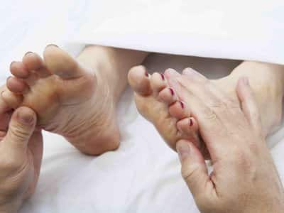 a foot doctor working on a patient