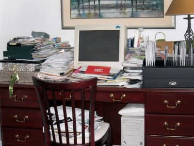 A desk overflowing with paper