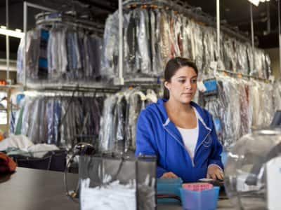 woman working at a dry cleaning and laundry