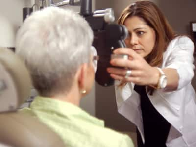 female eye doctor conducting exam