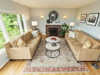 light hardwood floors, persian rug, couches
