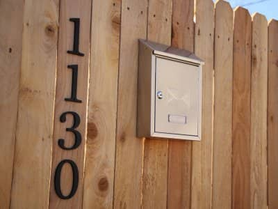 New wooden fence with mailbox