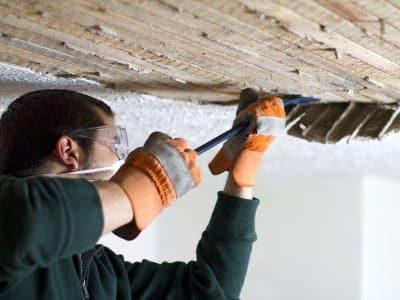 guy repairing plaster ceiling