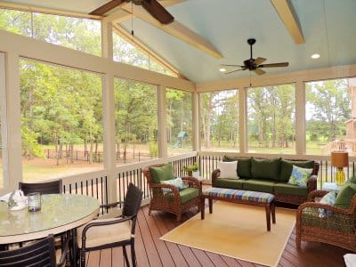 screened in porch with dining table and patio furniture set