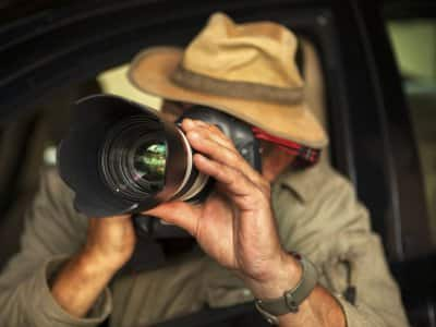 Private investigator with camera