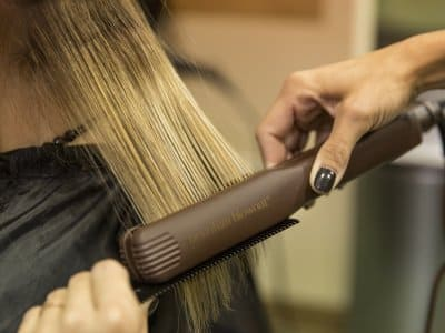 stylist straightening hair